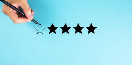 Hand draw a five star rating. evaluation and review concepts