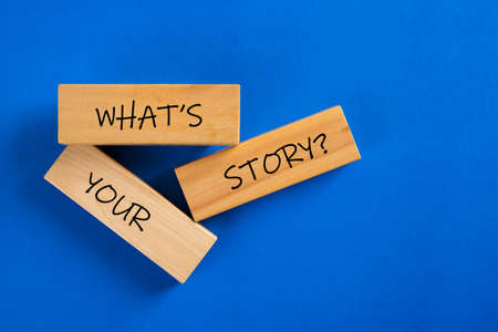 What's Your Story word on wooden block on blue background