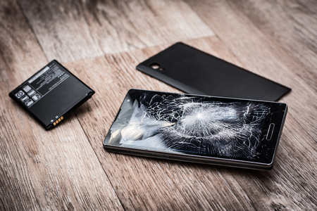 Broken mobile phone and parts