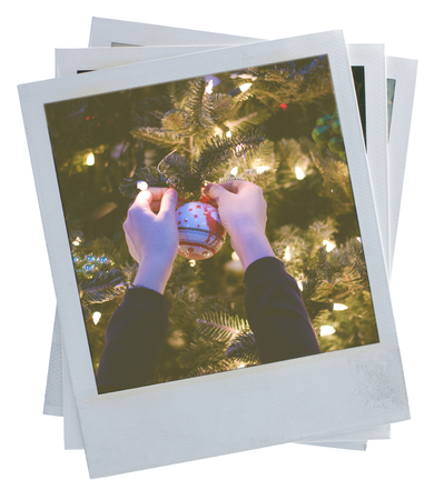 instant film transfer: Three aged retro polaroid photo frames on white with christmas ball and tree on it Stock Photo