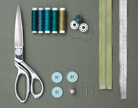 Sewing tools on green  background Stock Photo