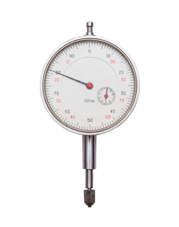 tarnish: Depth gauge laying on an isolated white studio background