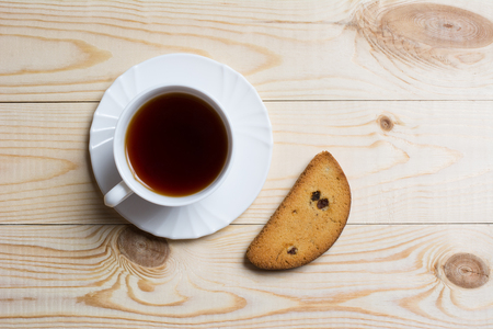 rusk: Cup of tea with piece of rusk bread