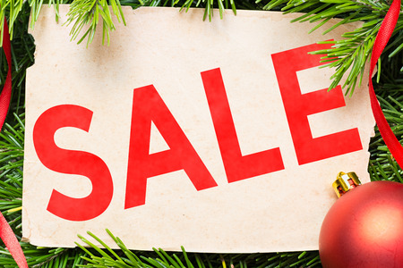 Sale concept. Christmas decoration and aged paper sheet