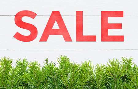 Christmas Sale. Fir tree on a wooden board Stock fotó