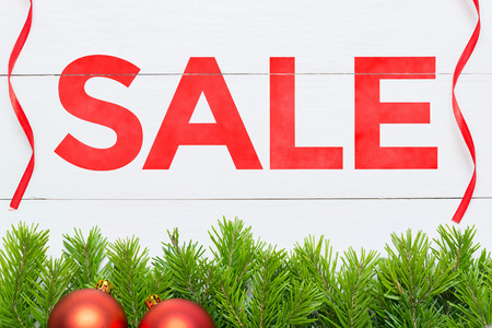 Christmas Sale concept. Fir tree on a wooden board