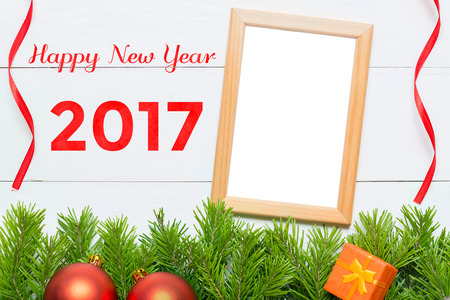 Happy New Year 2017. Christmas decoration and blank photo frame