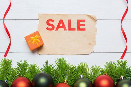 Christmas fir tree and aged paper sheet. Sale concept Stock fotó