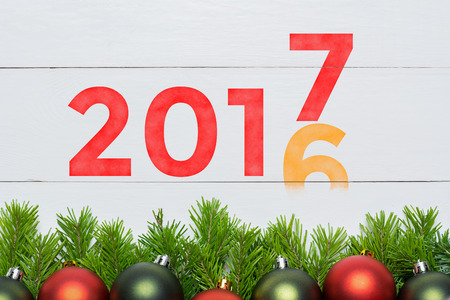 2016 year change to 2017. Christmas fir tree with decoration.
