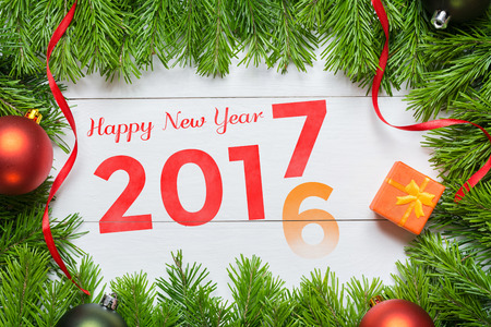 2016 year change to 2017. Christmas fir tree decoration.