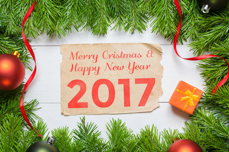 Christmas fir tree and aged paper. Happy New Year 2017