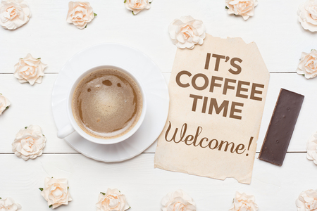 Cup of coffee and paper sheet. Its coffee time. Welcome!