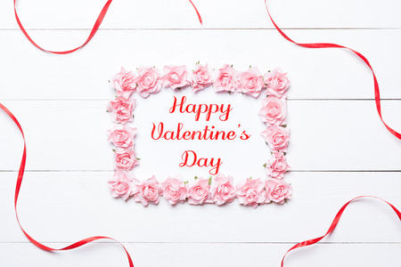 Happy Valentines Day concept in frame made of pink roses