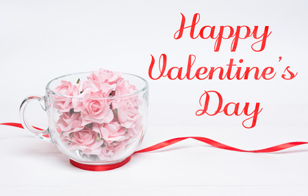 Happy Valentines Day concept. Glass cup full of pink roses