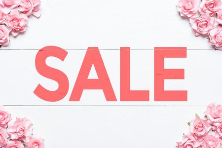 Sale concept. Pink roses frame background
