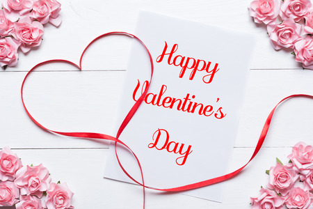 Red ribbon heart symbol. Happy Valentines Day concept