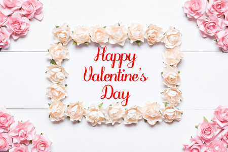 Happy Valentines Day concept. Frame made of white roses
