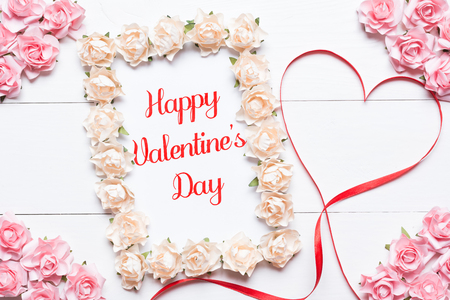 ribbon heart: Happy Valentines Day concept. Red ribbon heart symbol and roses