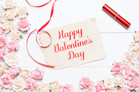 Happy Valentines Day concept on vintage paper sheet with roses