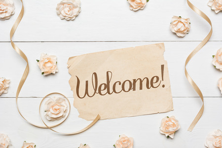 Welcome! Vintage paper sheet and white roses