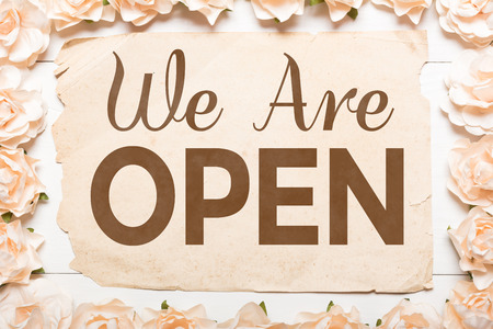We Are Open! White roses frame and paper sheet Imagens