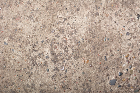 Rough cement texture with rocks background Imagens