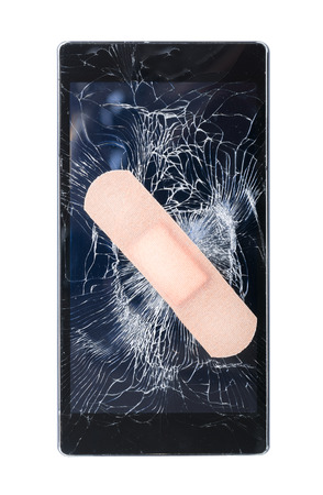 Mobile Smart Phone with cracked screen fixed with plaster