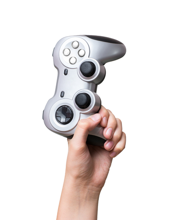 Game controller in hand raised up. Isolated on white