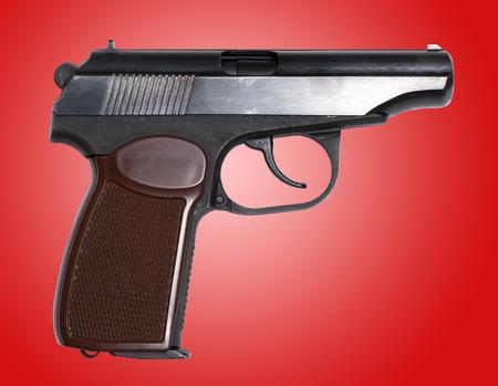 Old soviet handgun over red background