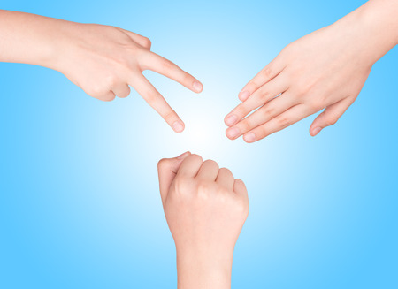 Hands making sign as rock paper and scissors on white Stock fotó