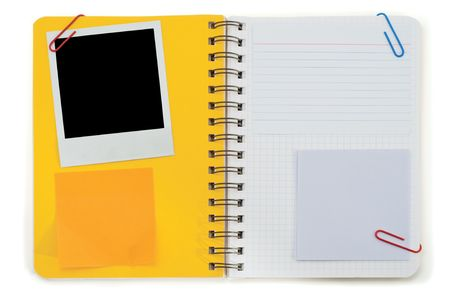 Spiral notepad and black instant photo isolated on a white Stock Photo - 4950016
