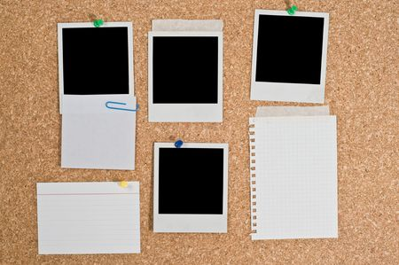 Cork board with blank instant photos and notes photo