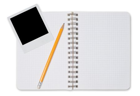 Spiral notepad and black instant photo isolated on a white Stock Photo - 4956998