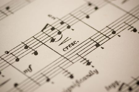orchestrate: Close-up of musical notes printed on a music sheet Stock Photo