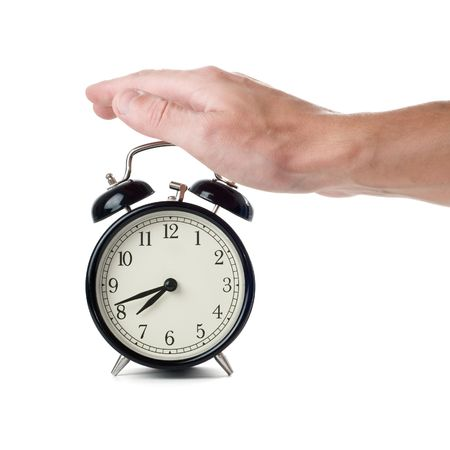 Alarm clock and hand isolated on a white Stock Photo - 4956934