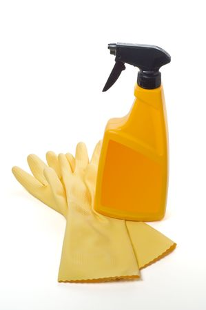 Spray bottle and protective gloves isolated on a white photo