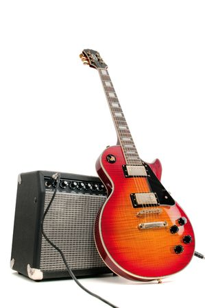 guitar amplifier: Electric guitar and amplifier isolated on a white