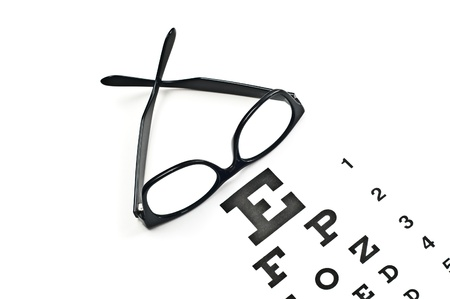glasses eye: Reading glasses with eye chart isolated on white