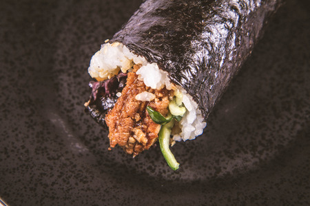 Sushi roll - japanese food on a black plate isolated on white background Reklamní fotografie - 115378780