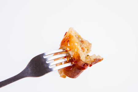 Chinese Traditional Spring roll with sweet and sour sauce eaten with a fork Stockfoto