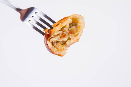 Chinese Traditional Spring roll with sweet and sour sauce eaten with a fork