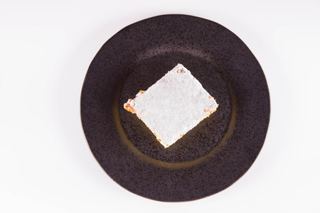 Napoleon cake - a Polish type of cream pie - sprinkled with powdered sugar
