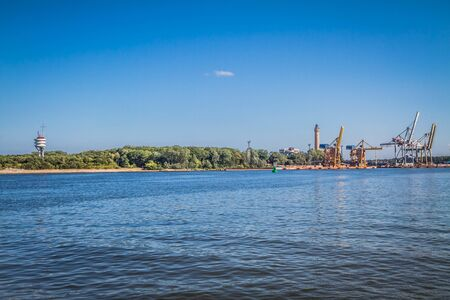 View of the harbor in Swinoujscie (Poland) across river Swina which separates the Wolin island from the Usedom island