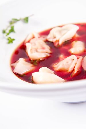 Polish Christmas Eve dish: clear borscht with dumplings (uszka)