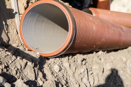 Underground pipes at a construction site waiting to be used