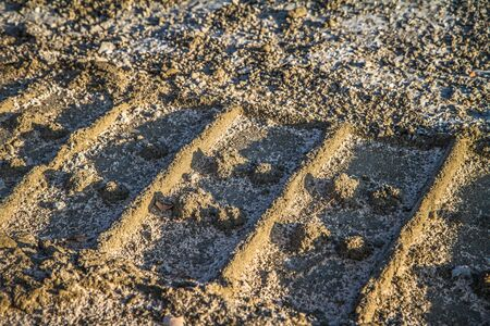 Tire tracks in mud at a construction site