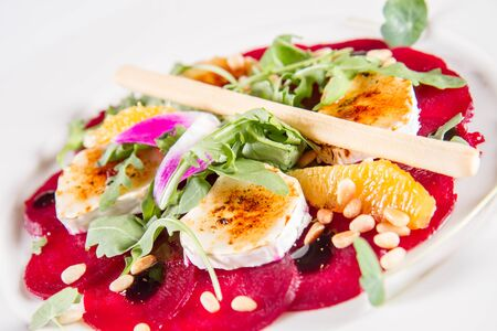 Beetroot carpaccio with goat cheese