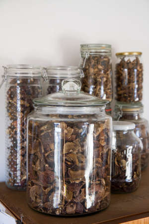 Dried mushrooms stored in glass jars