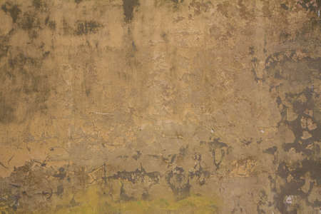 Wall with plaster coming off - vintage background Banque d'images