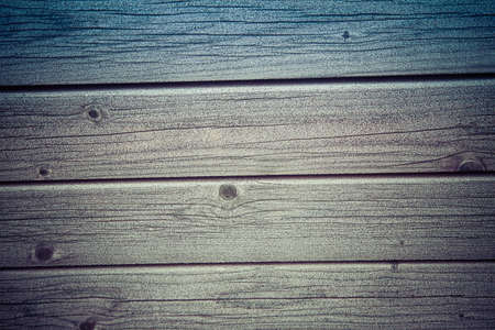 Frost covered wooden planks - a close up of a bench in winter